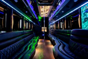Ultimate luxury party bus interior with custom lighting and stripper pole